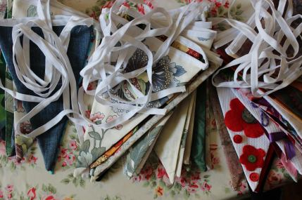 Our fabulous centenary bunting (with 100 pennants) made by our Knit & Stitch Club.
