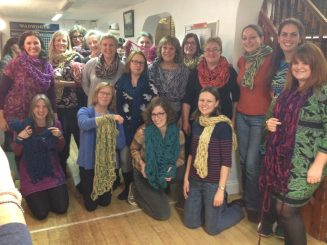 showing our arm knitted scarfs.